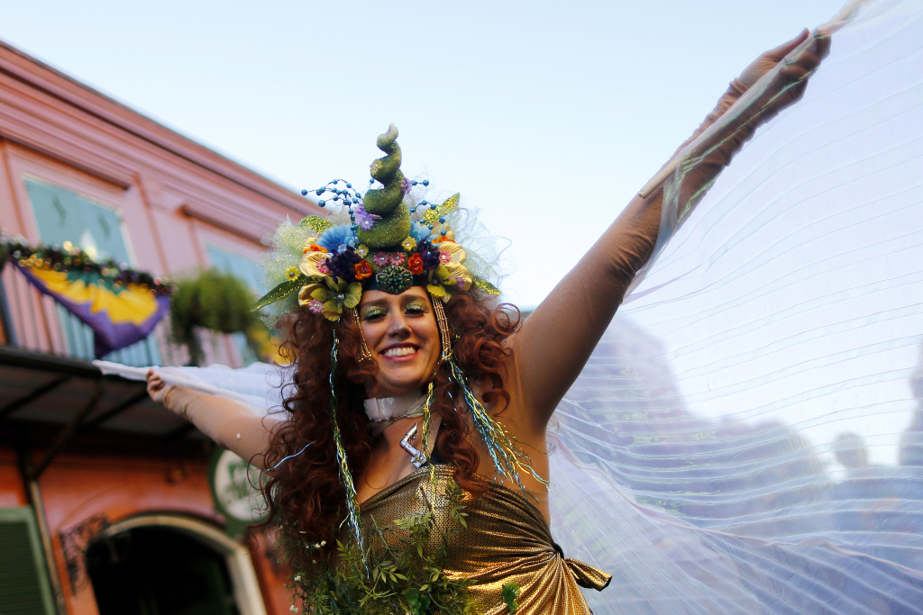 A reveler makes her way through the French Quarter of New Orleans, Louisiana during Mardi Gras festivities on February 9, 2016.