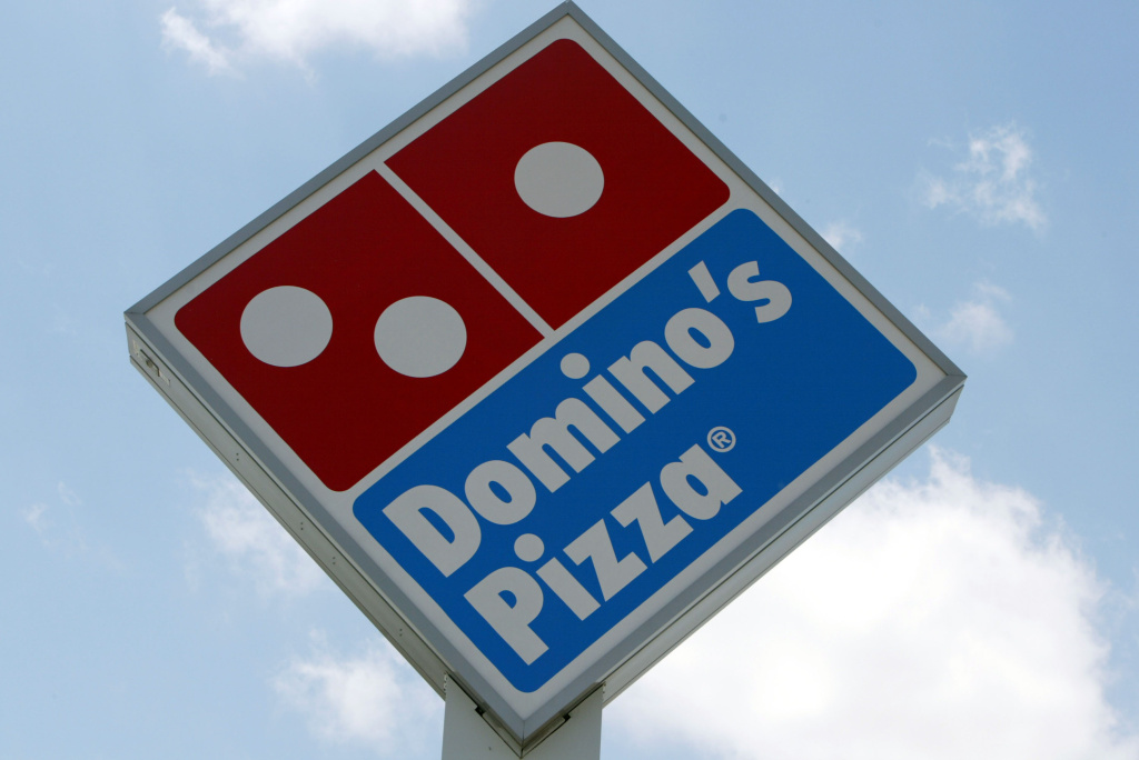 A sign in front of a  Domino's Pizza April 14, 2004 in Miami, Florida.