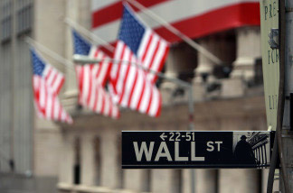 A Wall St. sign next to the New York Stock Exchange (NYSE) September 16, 2008 in New York City.
