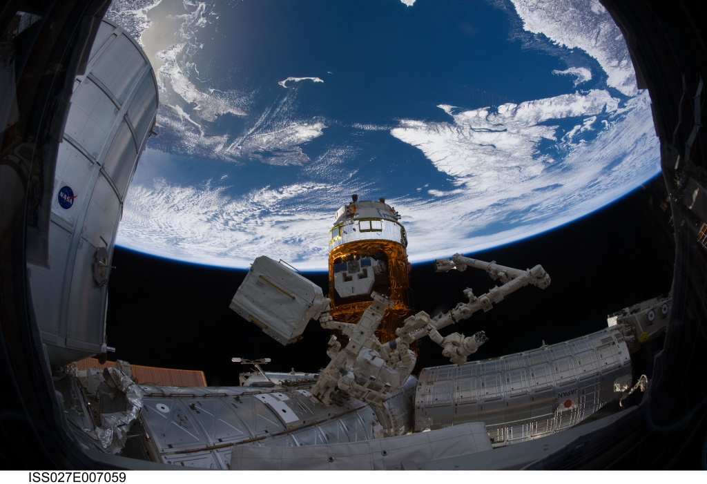 An Expedition 27 crew member used a fish-eye lens to capture this image of a portion of the International Space Station.