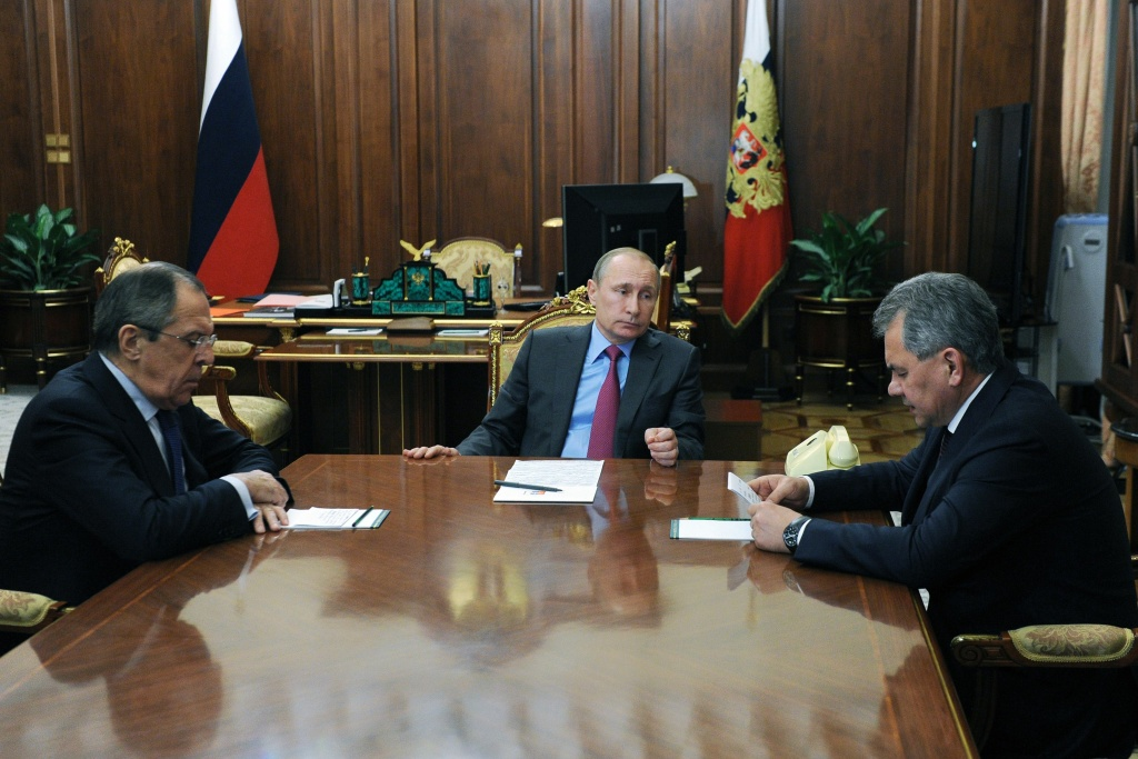 Russian President Vladimir Putin (C) meets with Defence Minister Sergei Shoigu (R) and Foreign Minister Sergei Lavrov (L). Putin ordered the defence ministry to begin the withdrawal of Russian forces from Syria.