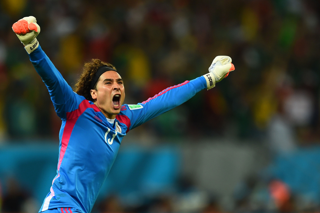 Guillermo Ochoa of Mexico celebrates his team's first goal during the 2014 FIFA World Cup Brazil Group A match between Croatia and Mexico at Arena Pernambuco on June 23, 2014 in Recife, Brazil.