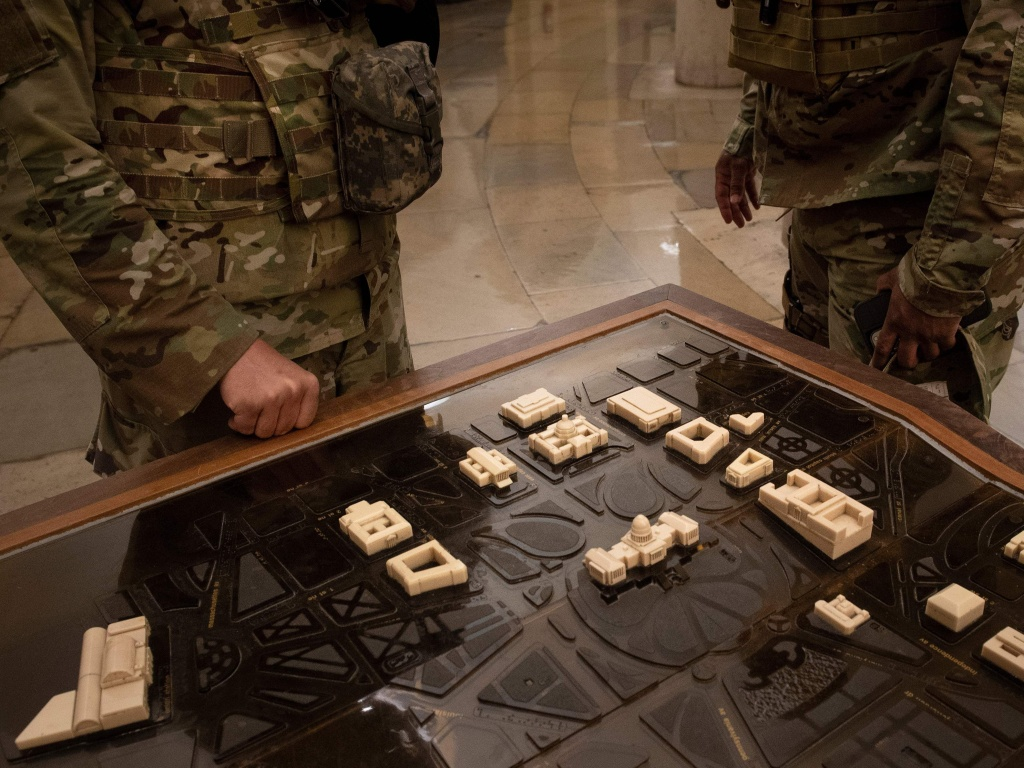 National Guard members examine a terrain model of Capitol Hill on Thursday. U.S. Capitol Police requested the guardsmen stay another two months after threats of further  violence emerged.