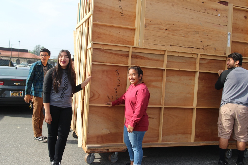 Students at James Monroe High School prepare to unload television flats delivered from Nickelodeon.