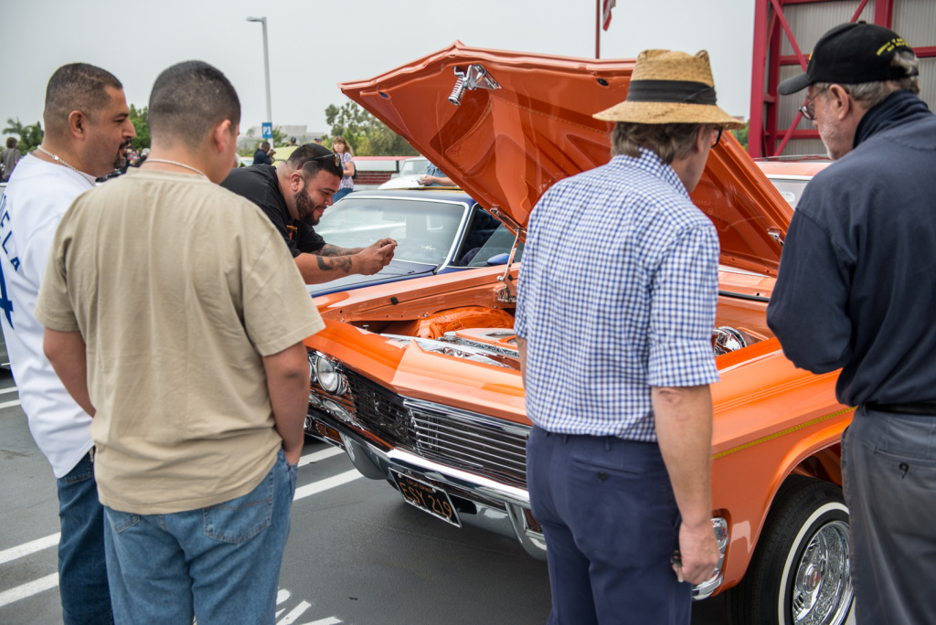 Admirers check out Jesse Saldana's 1965 Chevrolet Impala Super Sport, which won best in show at the Petersen's lowrider gathering.