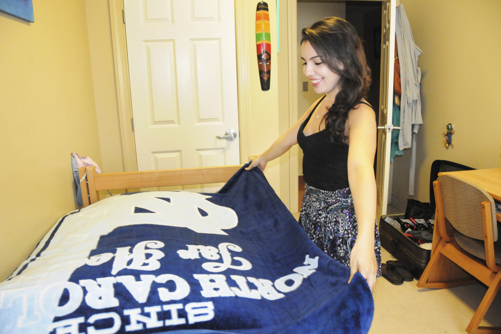 UNC Senior Andrea Zuniga, a transfer student from Miami, says she lives on campus with three of her best friends for the sense of community.