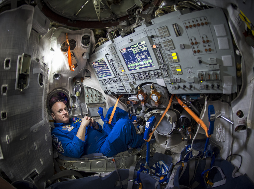 Astronaut Scott Kelly is seen inside a Russian Soyuz simulator in this file photo. Scott Kelly and two other astronauts had to prepare for a quick getaway from space junk by hunkering down into a Soyuz capsule docked to the International Space Station. Luckily, there was no impact.