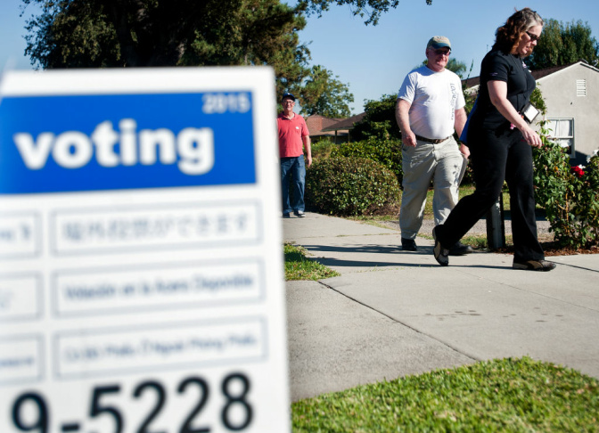 David Besbris, left, a member of SAG-AFTRA, Steve Flint, and Ellen McCrea, members of IATSA Local 600, canvass a Pasadena neighborhood during election day on Tuesday