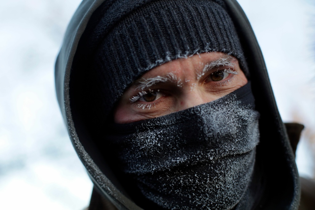 Frank Lettiere's eyebrows and eye lashes froze after his walk along Lake Michigan's Chicago shoreline Wednesday. Frostbite warnings were issued for parts of the U.S. Midwest, as outside temperatures plunged.