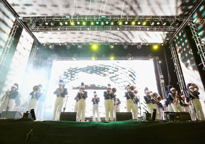 Shadow Hills High School marching band performs onstage with Big Gigantic during day 3 of the 2014 Coachella Valley Music & Arts Festival at the Empire Polo Club on April 13, 2014 in Indio, California.