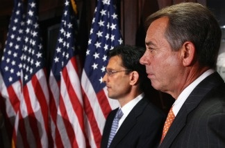 Speaker of the House John Boehner (R-OH) (R) and House Majority Leader Eric Cantor (R-VA) (L), listen to questions during a press conference following a meeting at the Republican National Committee offices July 26, 2011 in Washington, DC.