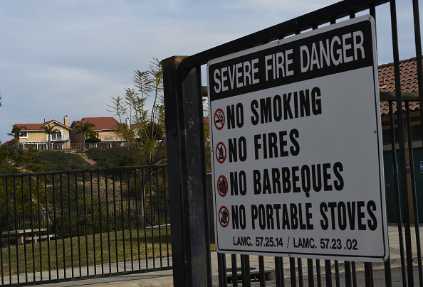 File: A sign warning of a severe fire danger placed outside a playground in the Los Angeles suburb of Porter Ranch on Jan. 22, 2016.
