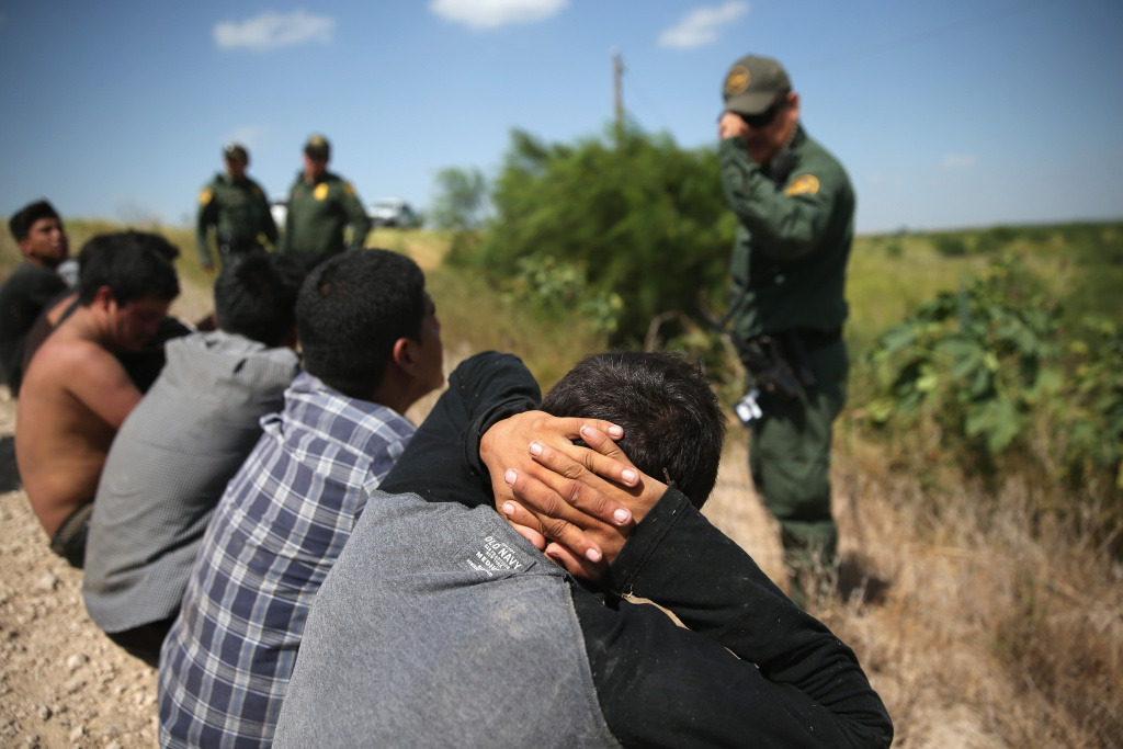 U.S. Border Patrol agents detain undocumented immigrants after they crossed the border from Mexico into the United States on August 7, 2015 in McAllen, Texas.