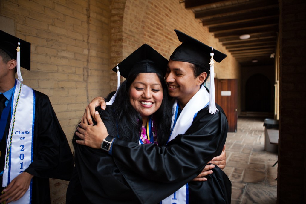 Two students hug as they are about to graduate from UCLA in 2012.