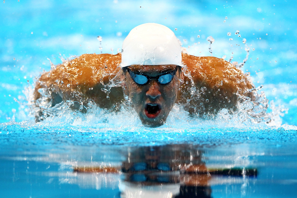 OMAHA, NE - JUNE 29:  Michael Phelps competes in preliminary heat 12 of the Men's 200 m Individual Medley during Day Five of the 2012 U.S. Olympic Swimming Team Trials at CenturyLink Center on June 29, 2012 in Omaha, Nebraska.  (Photo by Al Bello/Getty Images)