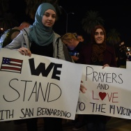 Samar Natori (L), from Redlands, CA, with family and friends who are all Muslims arrive at a candlelight vigil at the San Manuel Stadium in San Bernardino, California, December 3, 2015. Vigils were held all around the region to mourn the 14 victims of the previous day's mass shooting in San Bernardino.