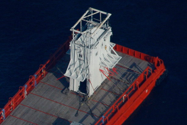 The Joe Griffin barge carrying the containment box, which will be used to try to contain the Deepwater Horizon oil spill, sits surrounded by oil on May 6, 2010 in the Gulf of Mexico. The Deepwater Horizon oil rig operated by BP is leaking an estimated 5,000 barrels of oil a day into the Gulf.