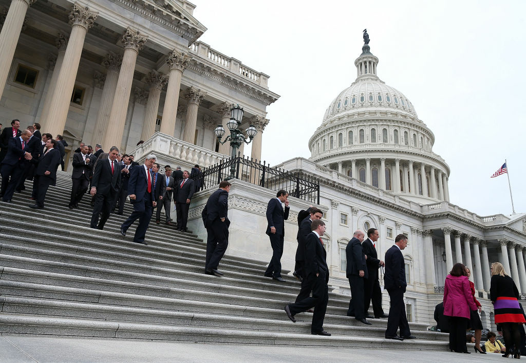 Newly elected Congressional freshmen of the 113th Congress walk away after a class picture on November 15, 2012 in Washington DC. The sitting duck Congress will have to make a decision about the fiscal cliff before they take office.