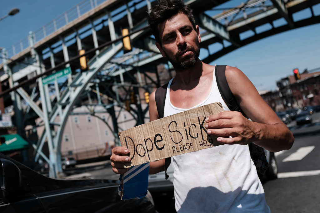 Mike, a heroin addict who wants to get help, panhandles for money in the Kensington section of Philadelphia, which has become a hub for heroin addicts, on July 21, 2017.