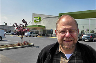 Business commentator Mark Lacter standing in the nearly empty parking lot at the Fresh 'n' Easy store in The Comptons.