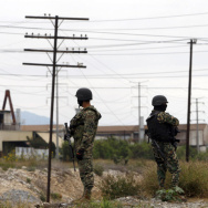 Three members of the Mexican Army watch