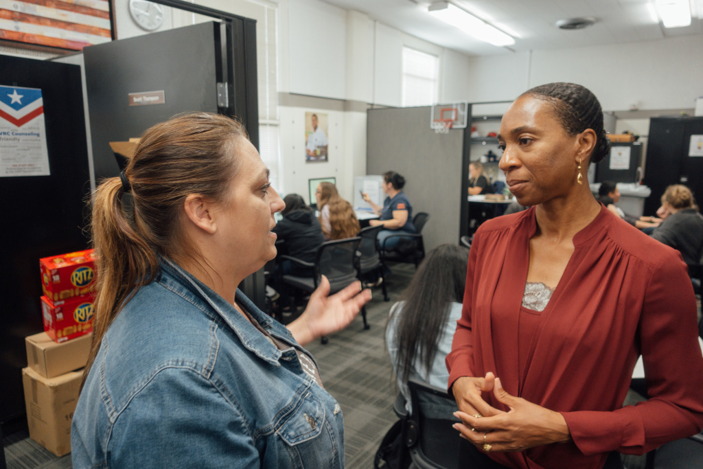 Dr. Miatta Snetter (right) speaks to Marine Corps veteran Sherry Pope at the Fullerton College Veterans Resource Center.