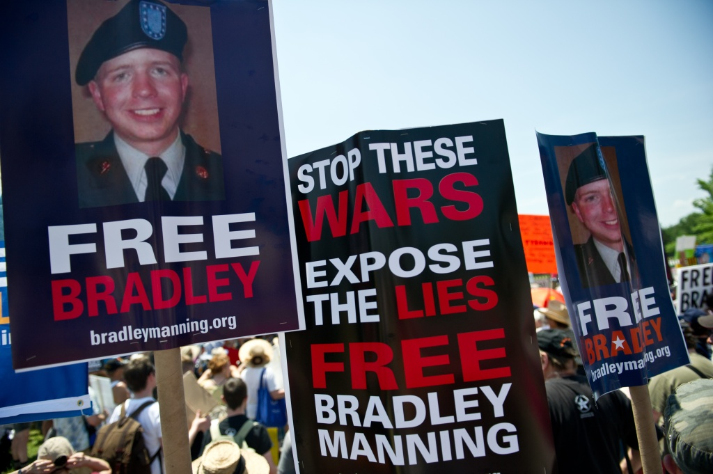 People gather on June 1, 2013 during a demonstration in support of Wikileaks whistleblower US Army Private Bradley Manning at Fort Meade in Maryland, where Manning's court martial will begin on June 3.
