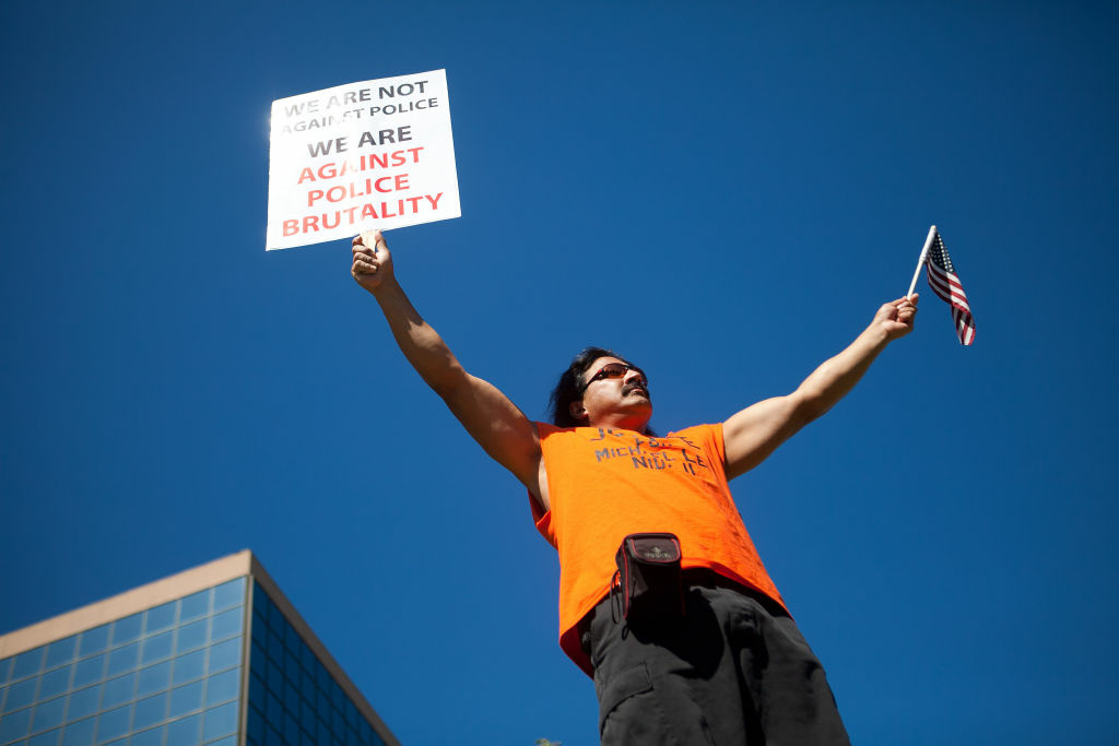 A protester marches through the streets of Anaheim to show outrage for the shooting death of Manuel Angel Diaz, 25, at Anaheim City Hall on July 24, 2012 in Anaheim, California. Diaz was fatally shot July 21 by an Anaheim police officer and has sparked days of protests by the angered community.