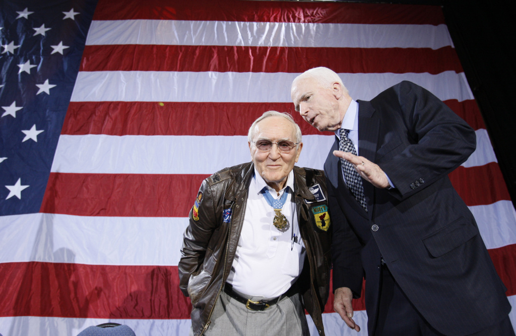 Retired U.S. Air Force Col. Bud Day, left, who was a prisoner of war in Vietnam with Republican presidential hopeful, Sen. John McCain, R-Ariz., right, talk during a campaign rally at the Emerald Creek Conference Center in Ft. Walton Beach, Fla., Tuesday, Jan. 22, 2008