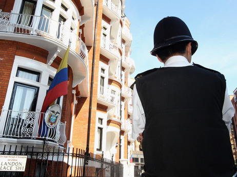 A British police officer stood outside the Ecuadorian consulate in London June 20, 2012, as WikiLeaks founder Julian Assange remained inside.