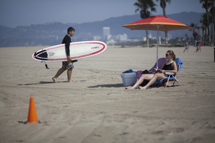 A Los Angeles County lifeguard patrols Venice beach a day after a rare lightning storm struck multiple people and killed a swimmer.