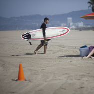 Beach goers soak in the morning sunshine on Venice beach.