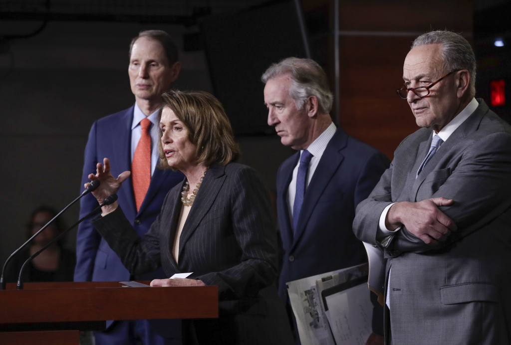 From left, Sen. Ron Wyden, D-Ore., House Minority Leader Nancy Pelosi, D-Calif., Rep. Richard Neal, D-Mass., and Senate Minority Leader Chuck Schumer, D-N.Y., hold a news conference in this Nov. 2, 2017 file photo. Pelosi and Schumer pulled out of a budget meeting with Trump after the president tweeted that he didn't see a deal happening to keep the government funded past Dec. 8.