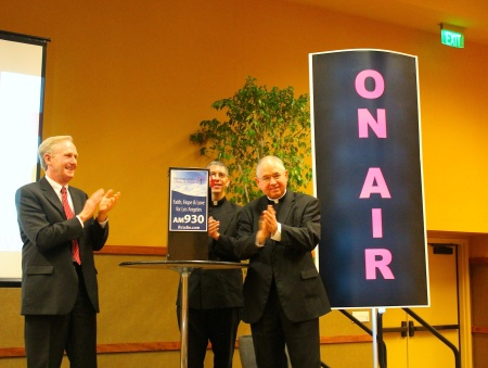 Immaculate Heart Radio president Doug Sherman (l.) celebrates the launch of a new English-language Catholic radio station in Los Angeles with Archbishop José Gomez and Father Ed Benioff.