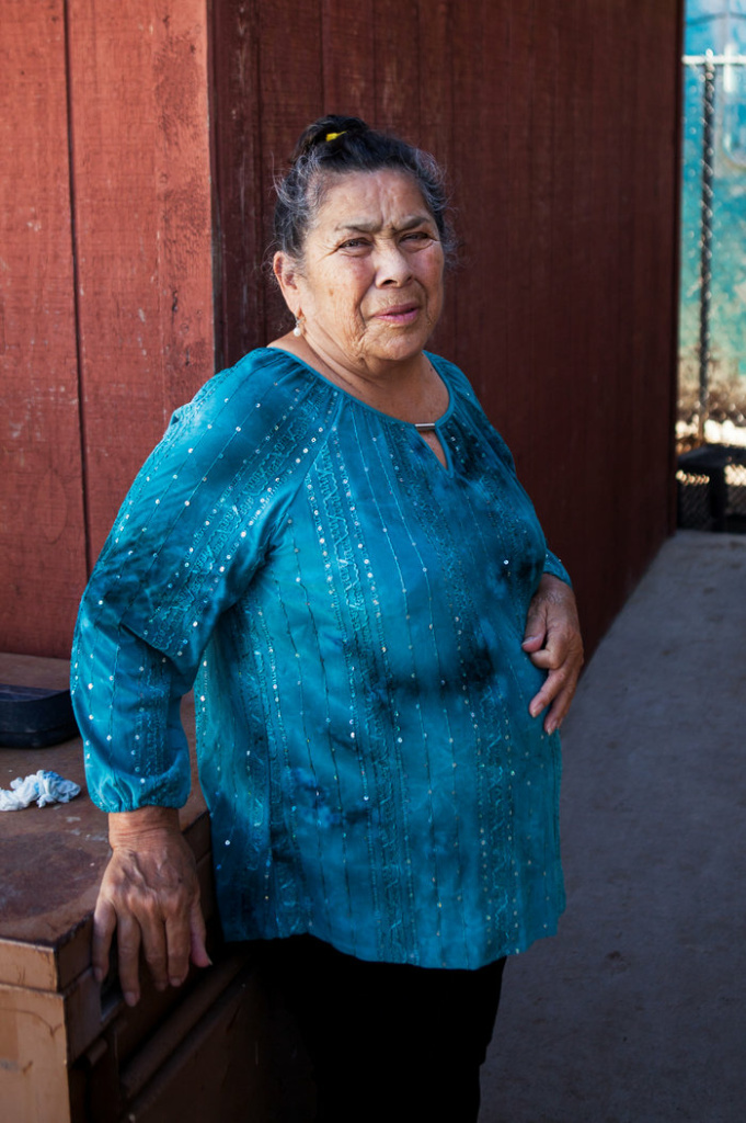 Palma's mother, Rita, stands outside the family's house in El Paso. She says her son was born in Ciudad Juárez, Mexico, because she did not have enough money to give birth at an American hospital.