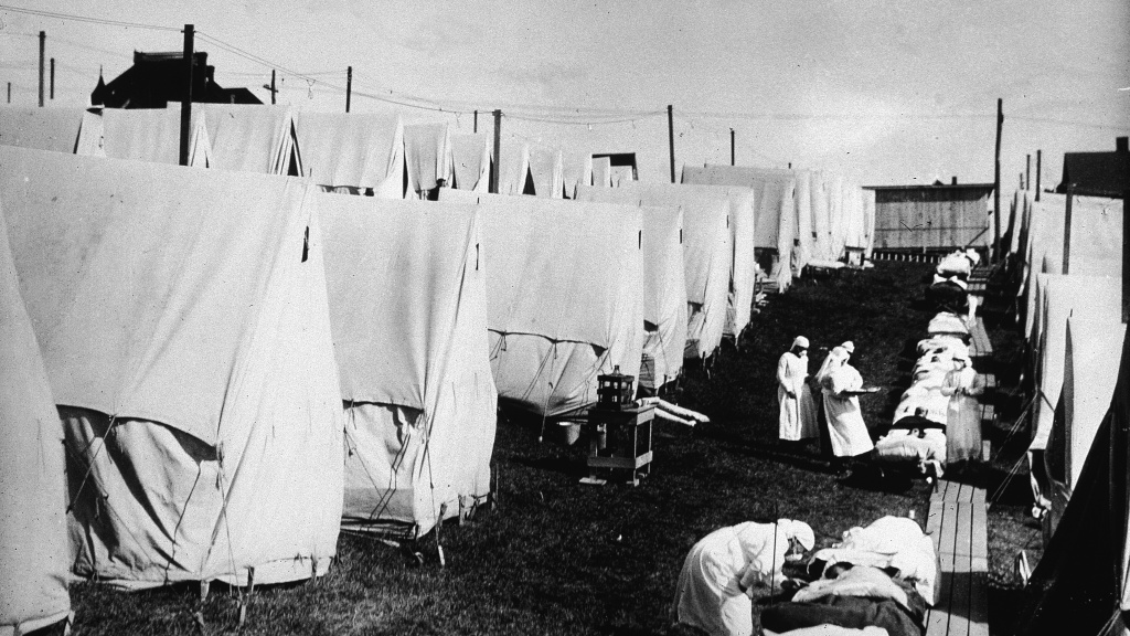 Nurses in Lawrence, Mass., care for victims of the flu epidemic in 1918.