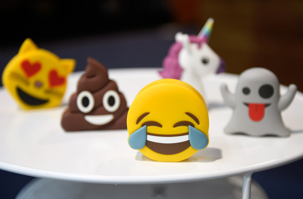 Batteries designed as emojis are displayed at the Philo booth at CES 2017 at the Las Vegas Convention Center on January 6, 2017 in Las Vegas, Nevada.