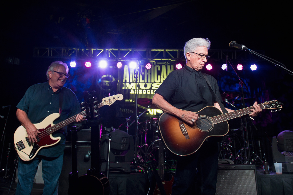 Louie Pérez, right, and Conrad Lozano of Los Lobos perform at the 2015 Americana Music Awards in  Nashville, where the band was given a Lifetime Achievement Award.