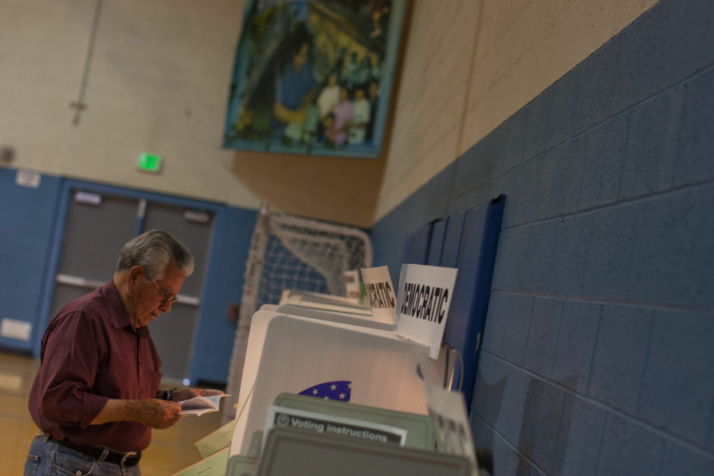 Pedro Rios casts his ballot in the June 5 presidential primary election at Estrada Court Community Center in Boyle Heights.
