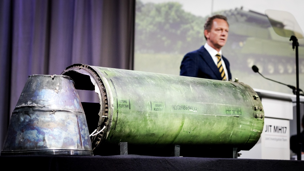 Head prosecutor Fred Westerbeke speaks next to a part of the Buk rocket that was fired on Flight MH17 during the news conference of the Joint Investigation Team in Bunnik, Netherlands, on Thursday.