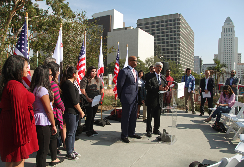 Attorneys Theodore Boutrous, right at podium, and Marcellus McRae, left at podium, take questions from the media, and are joined by nine California public school students who are suing the state to abolish its laws on teacher tenure, seniority and other protections, during a news conference outside the Los Angeles Superior court Monday, Jan. 27, 2014 in Los Angeles.