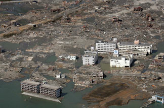 This aerial view taken on March 14, 2011 during an AFP-chartered flight shows an area destroyed by the tsunami in Minamisanriku, in Miyagi prefecture three days after a massive 8.9 magnitude earthquake and tsunami devastated the coast of eastern Japan.