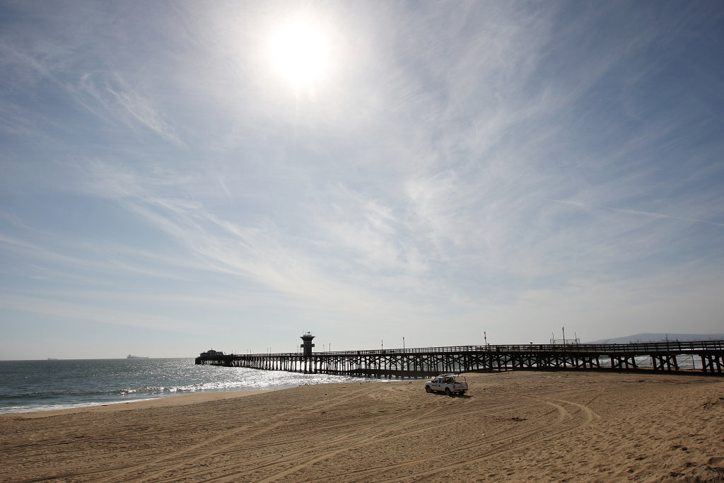 SEAL BEACH, CA - MARCH 11:  A lifeguard patrols Seal Beach, which was closed by authorities as a precaution against a possible tsunami following a massive earthquake in Japan March 11, 2011 in Seal Beach, California.