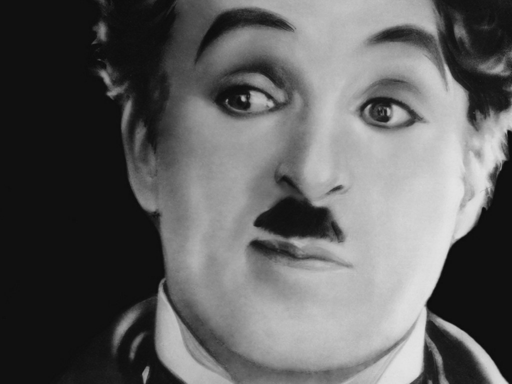 Movie still of Charlie Chaplin in the film, The Great Dictator.