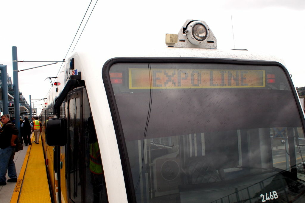 Safety ambassadors along the Expo Line are trying to change the behaviors of drivers and pedestrians, who are not used to the presence of the new light rail line.