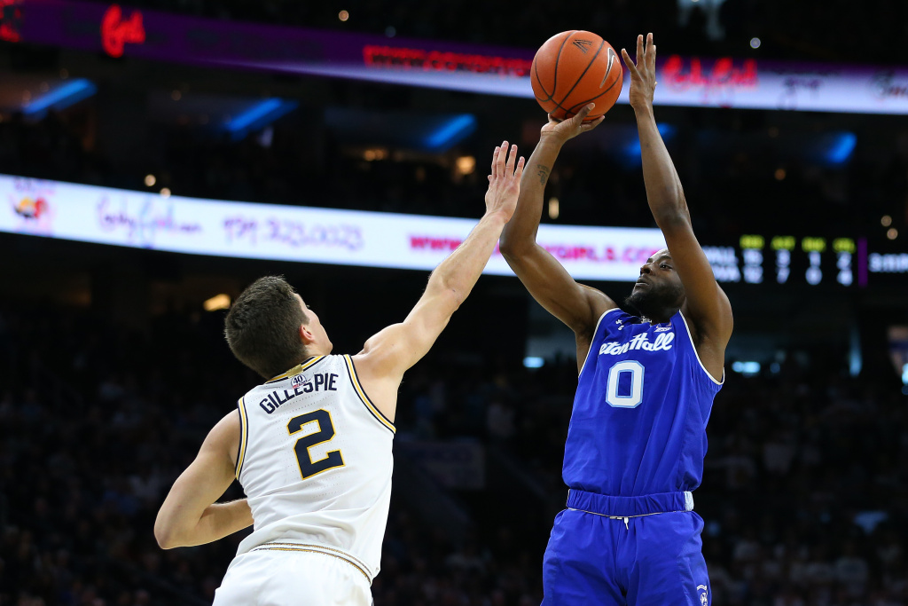 Quincy McKnight of the Seton Hall Pirates attempts a shot as Collin Gillespie of the Villanova Wildcats defends during the first half of a college basketball game at Wells Fargo Center on February 8, 2020 in Philadelphia, Pennsylvania.
