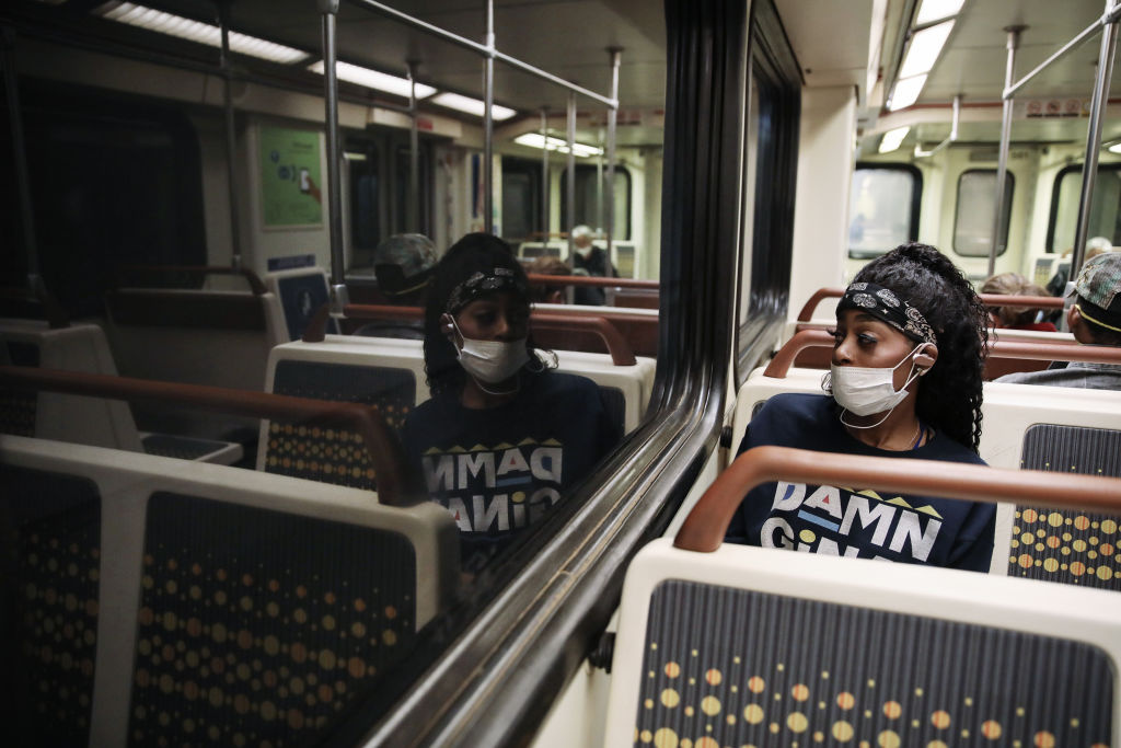 A woman wears a face mask while riding a Los Angeles Metro Rail train amid the coronavirus pandemic on April 1, 2020 in Los Angeles, California.