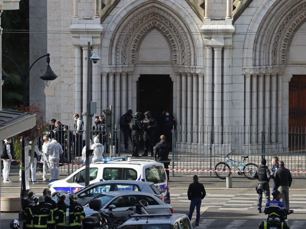 French members of the RAID elite tactical police unit search the Notre Dame Basilica after a knife attack in Nice. A man wielding a knife killed three people and injured several others in Thursday's attack, officials said. The suspected assailant was detained shortly afterwards.
