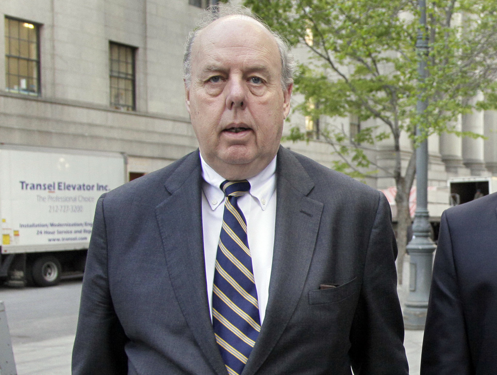 In this April 29, 20111, file photo, attorney John Dowd walks in New York. Dowd, President Donald Trump's lead lawyer in the Russia investigation, has left the legal team and says he