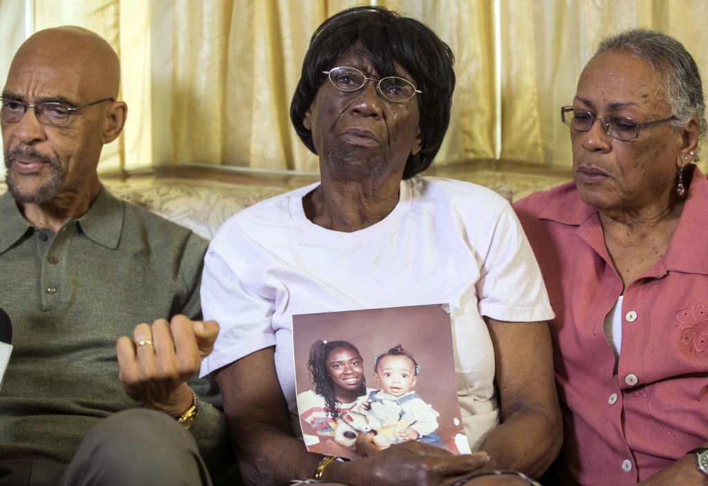 Earl Ofari Hutchinson, founder of the Los Angeles Urban Policy Roundtable, left,  Ada Moses, 91, the grandmother of Alesia Thomas, who died in 2012 after allegedly being kicked by a Los Angeles Police Department  officer while handcuffed.